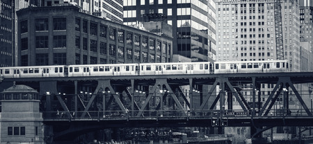 Black and white view of elevated railway train in Chicago, USA. Редакционное