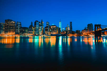 New York City Manhattan midtown at dusk with skyscrapers illuminated over east river Stock Photo