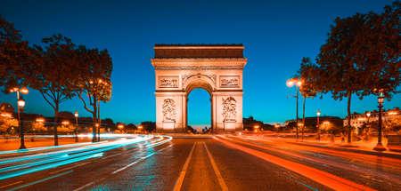 Famous Arc de Triomphe at night, Paris, France.