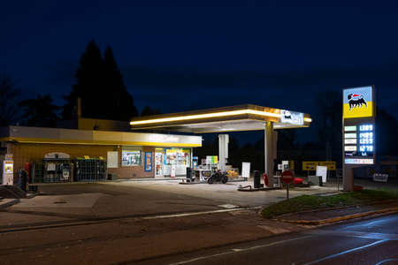 Charbonnieres-les-Bains, FRANCE - NOV 02, 2020: AGIP Gas station in France at night. Agip is part of the ENI Group Editorial