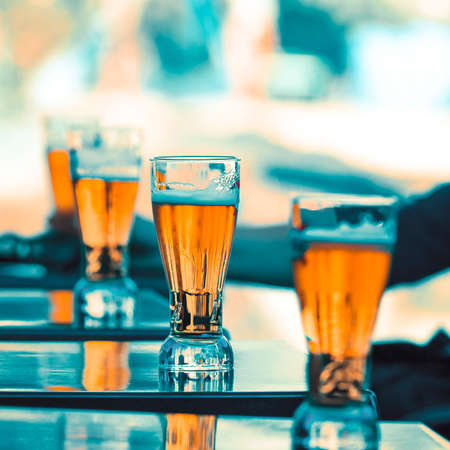 glasses of beer on a table in a restaurant