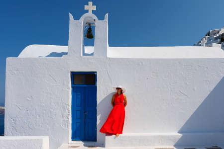 Woman in front of church in Santorini, Greece