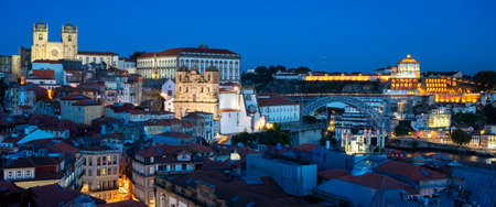 Famous view of Porto by night with moon, Portugal, Europe 免版税图像