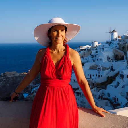 Beautiful woman in Oia, Santorini, Greece