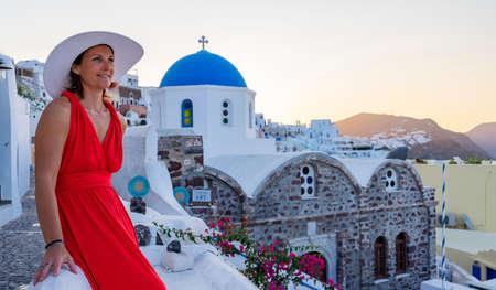 Beautiful womanwith hat in Oia, Santorini, Greece
