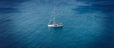 Lonely boat on the sea, Milos, Greece 免版税图像
