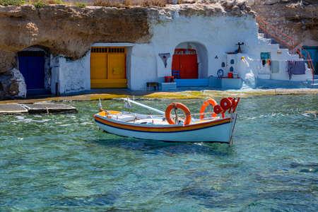 Little boat in traditional harbor in Milos, Greece