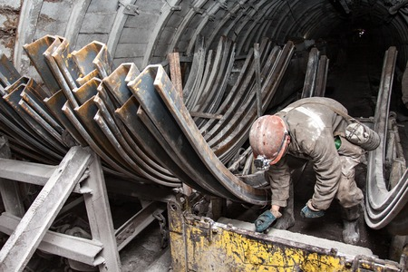 coal miner: miner performs work in a mine