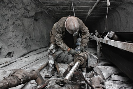 underground: miner performs work in a mine