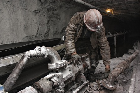 coal mine: miner performs work in a mine