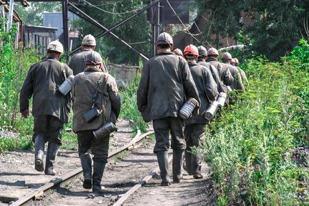 after work: Miner change goes on rails after work shift Stock Photo
