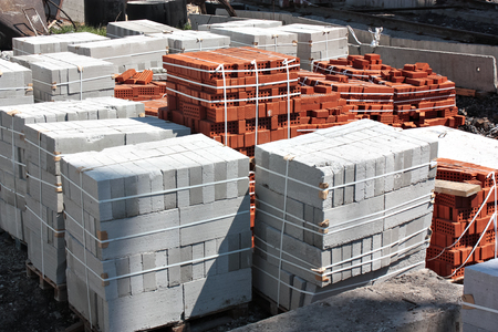 bricks and concrete blocks in the package on a building site