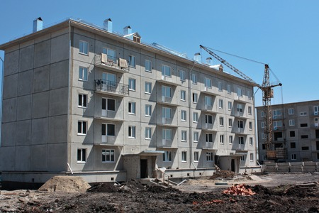 prefabricated: summer construction site prefabricated house