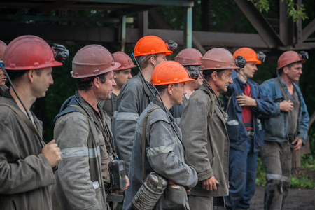 Miners working in anticipation of transport, before sending on change