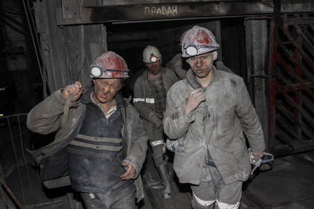 Miners are directed to the shift in the mine on the bus Editorial