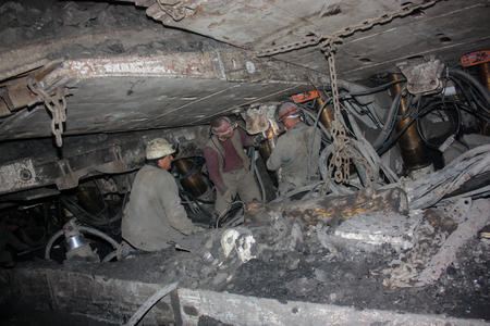 Miners perform installation of structures below ground in the mine