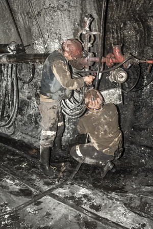 miner performs work in a mine