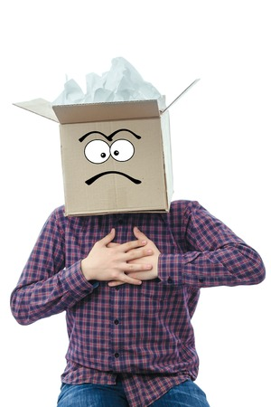 a man with a cardboard box on his head on a white background reading