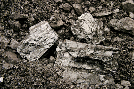 Heap of coal. A place, where coal is stored for selling. Stock Photo