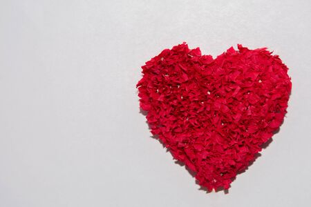 Symbolic plush red heart isolated over the white background. St. Valentines day fluffy simbol