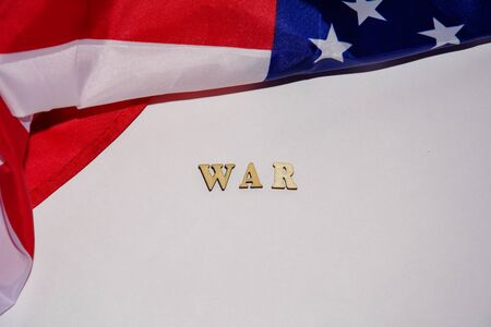 American flag on a white background and the word WAR. Concept of conflict, confrontation, political disagreement