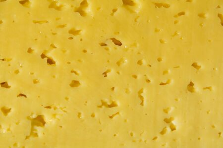 View of shredded yellow cheese. close-up background and texture Stock Photo