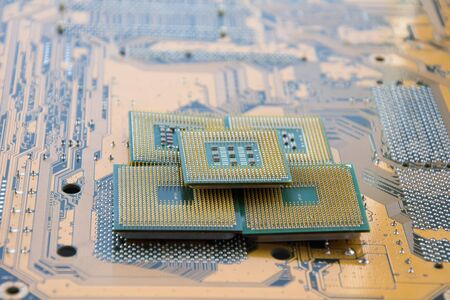 Many computer CPU close-up on the motherboard background, socket of central process unit, connection of cpu with motherboard, the structure of the processor chip, multi-core and multi-threading.