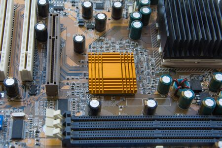 CPU socket on motherboard computer with installed a processor and radiator cooling or heat sink.