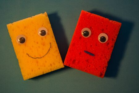 Two friends is a Fun spongewith eyes. Sponge cartoons concept on blue background.