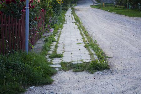 dusty dirty street, bad unpaved road, poor road. Stock fotó