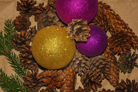 Christmas composition. Pine and fir cones, Christmas balls, green branches of the Christmas tree.
