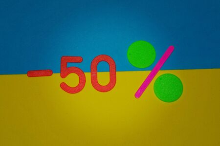 Plate minus 50 percent on yellow and blue background . Winter Merry Christmas, New year sale. 50 off discount promotion sale poster, banner, ads in store, shop, drugstore, market window.