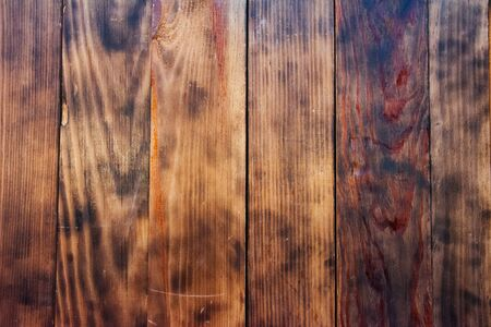 Old grunge rustic vintage dark textured wooden background. The surface of the old brown wood texture,top view brown wood paneling. Old grunge dark textured wooden background. Banco de Imagens
