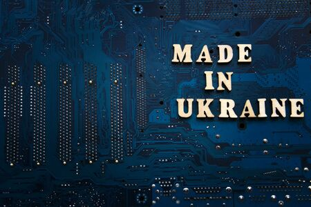 Made in Ukraine. Inscription on a blue electronic printed circuit board. Background with copyspace for design. Repair and maintenance electronics concept. Stock fotó