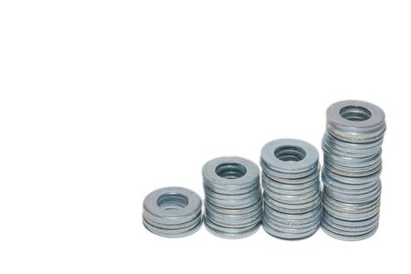 Metal round washers with holes folded into stacks isolated on white background with copyspace.
