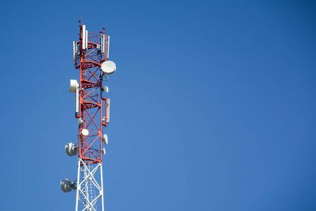 Base Station Telecommunication tower. Wireless Communication Antenna Transmitter on blue background with copyspace. 4g or 5G Network Connection Concept. Conspiracy theory, dangers Radiation.
