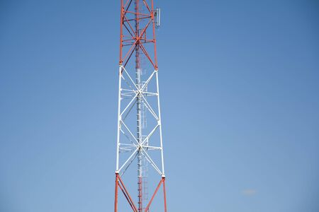 Telecommunication the cell phone tower on blue sky background. Mast communication technology network concept