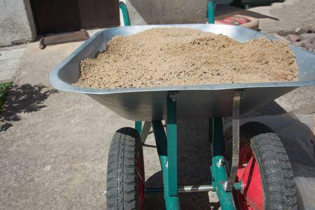 Garden metal wheelbarrow cart on construction site