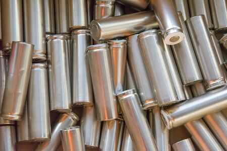 Set of machined metal parts. Cylindrical parts, spare parts, batteries. Abstract industrial background. Фото со стока