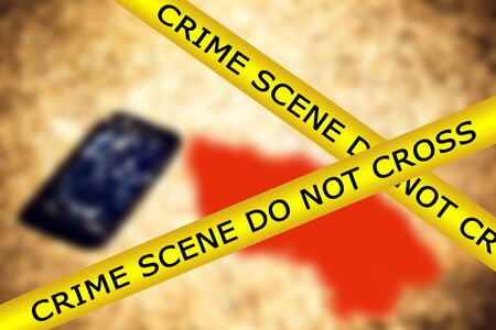 Yellow police tape with sign text: crime scene do not cross on broken smartphone and bloodstain background. The fence of the crime scene and evidence and spot of blood.