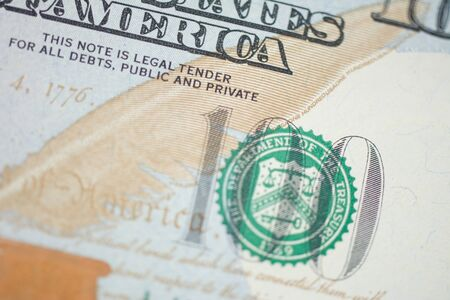 Fragment of 100 U.S. dollar bill close up. Part of hundred dollar banknote. Money texture. Banking and financial concept