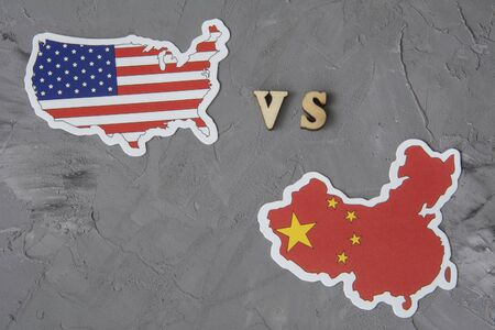 Flags of USA and China. Conflict between country. Global financial trade war of America vs China battle trade war crisis Фото со стока