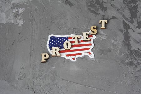 Protest sign flat lay on a gray background with american flag
