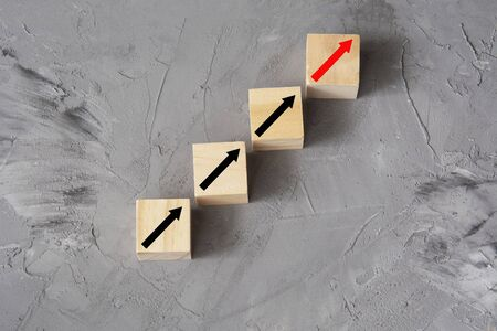 Business concept growth success process. Ladder career path and growth success process. Target of investment. Wooden cubes with up arrows sign, place for text
