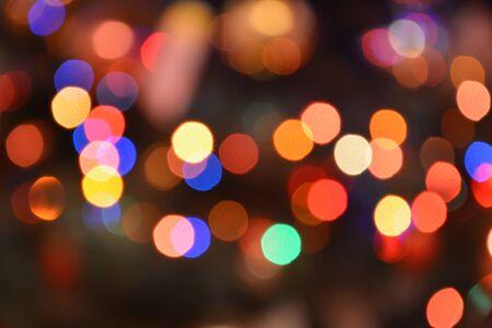 Festive bokeh glitters background. Light abstract texture