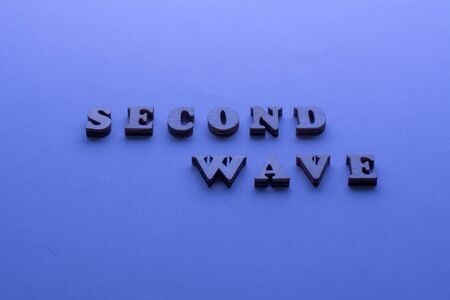 Second wave COVID19 text on blue background. 2nd Wave of Coronavirus is coming