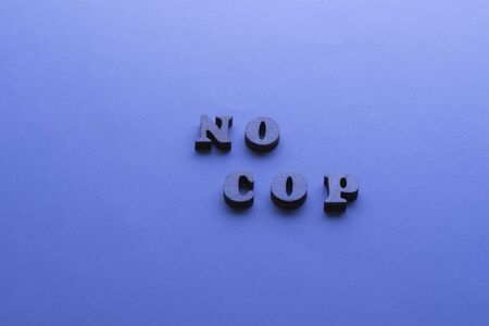 No cop sign flat lay on blue background with. Concept of Discrimination, racial problems Фото со стока