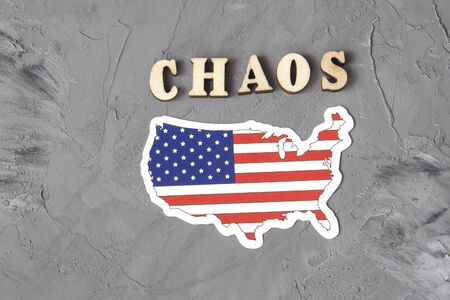 The word Chaos sign on gray background with american flag