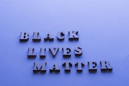 Text Black Lives Matter on blue background with. Concept of Discrimination, racial problems