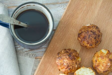 Homemade muffin and cups of coffee on wooden table, closeup. Delicious dessert. Breakfast background. Фото со стока